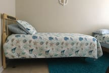 Twin and double beds with private full bathroom.