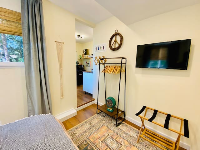 Bedroom - includes tv, clothes rack, luggage stand