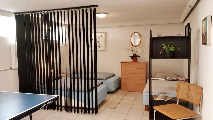 Bedroom number 2 with 4 single beds, you can lock the door in this room plus play table tennis.