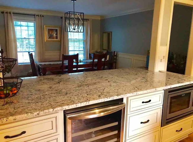 Newly renovated kitchen opens up into spacious dining room.  Perfect space for entertaining.