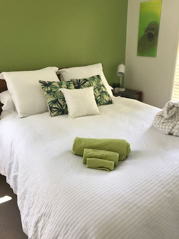 Sunny bedroom greets the new day. In wintertime, your queen bed beckons with sumptuous duvet and French linen.