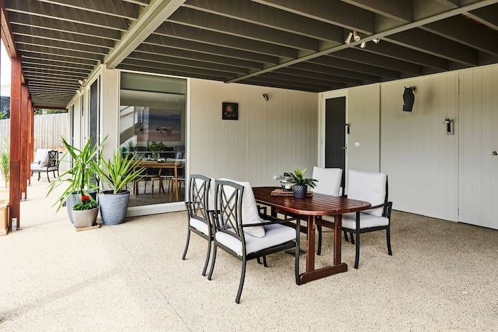Enjoy the views from the alfresco area with table and chairs and barbecue