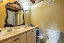 The ground floor bathroom has dual sinks, a large vanity, and a walk-in shower.