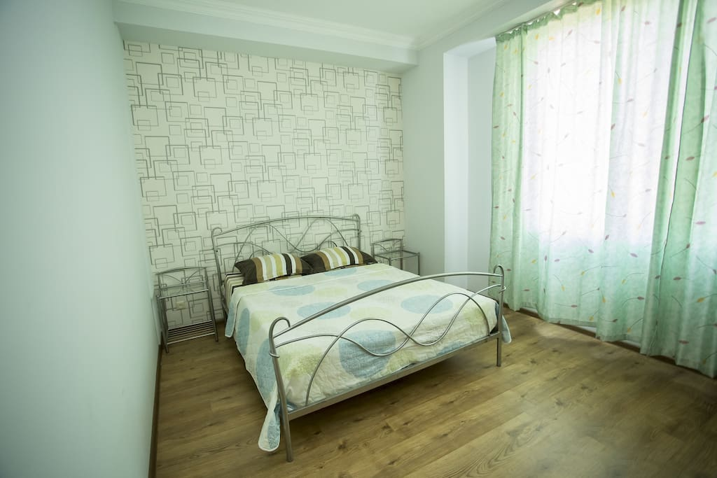 The main bedroom has big windows were you will get a beautiful view on the greenery