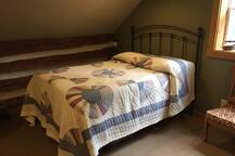Log bedroom with double bed