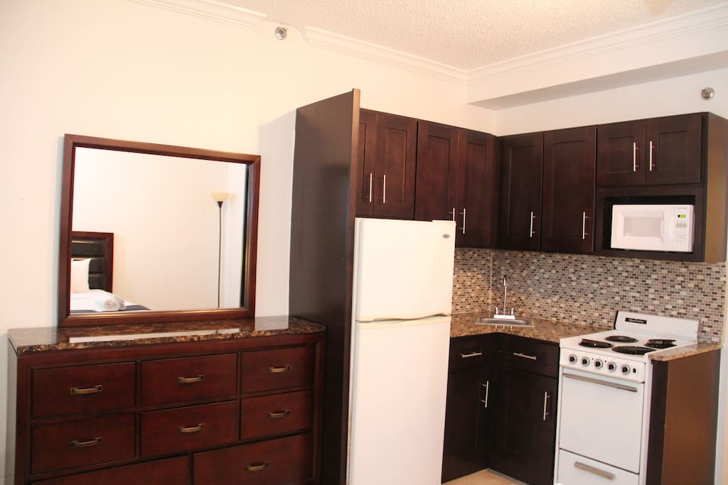 Full Equipped Kitchenette.Refrigerator,stove,oven,microwave, utensils,and Coffeemaker