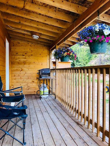 Deck with seating and bbq.