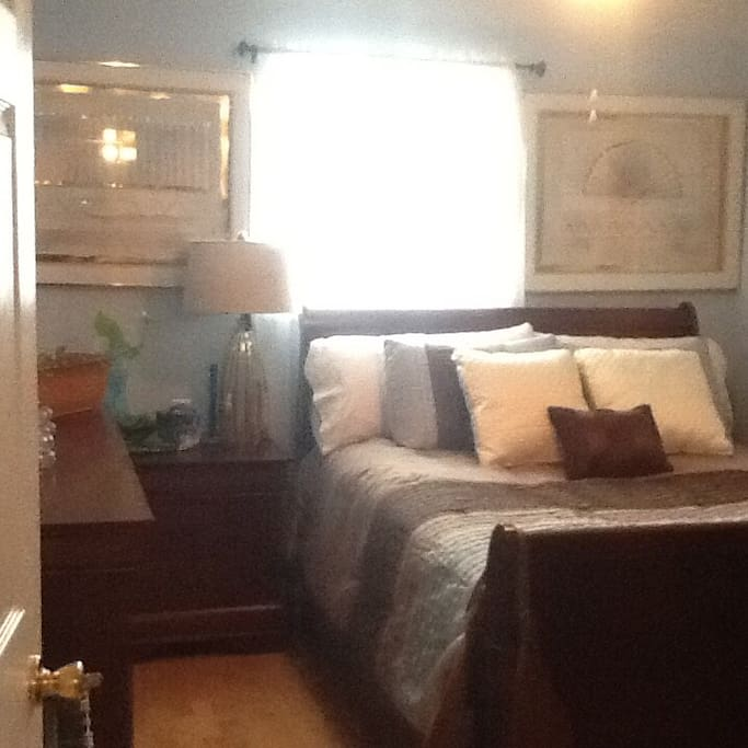 The guest bedroom with queen bed and dresser nite stand with a space in the closet to hang cloths!