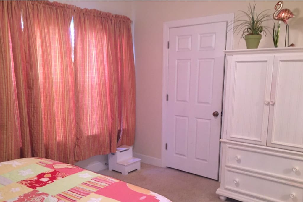 Master bedroom large closet & armoire with tv