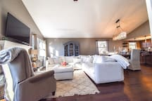 Cozy living room with an extremely comfortable large down cushion sectional to relax on. Perfect space for hosting!