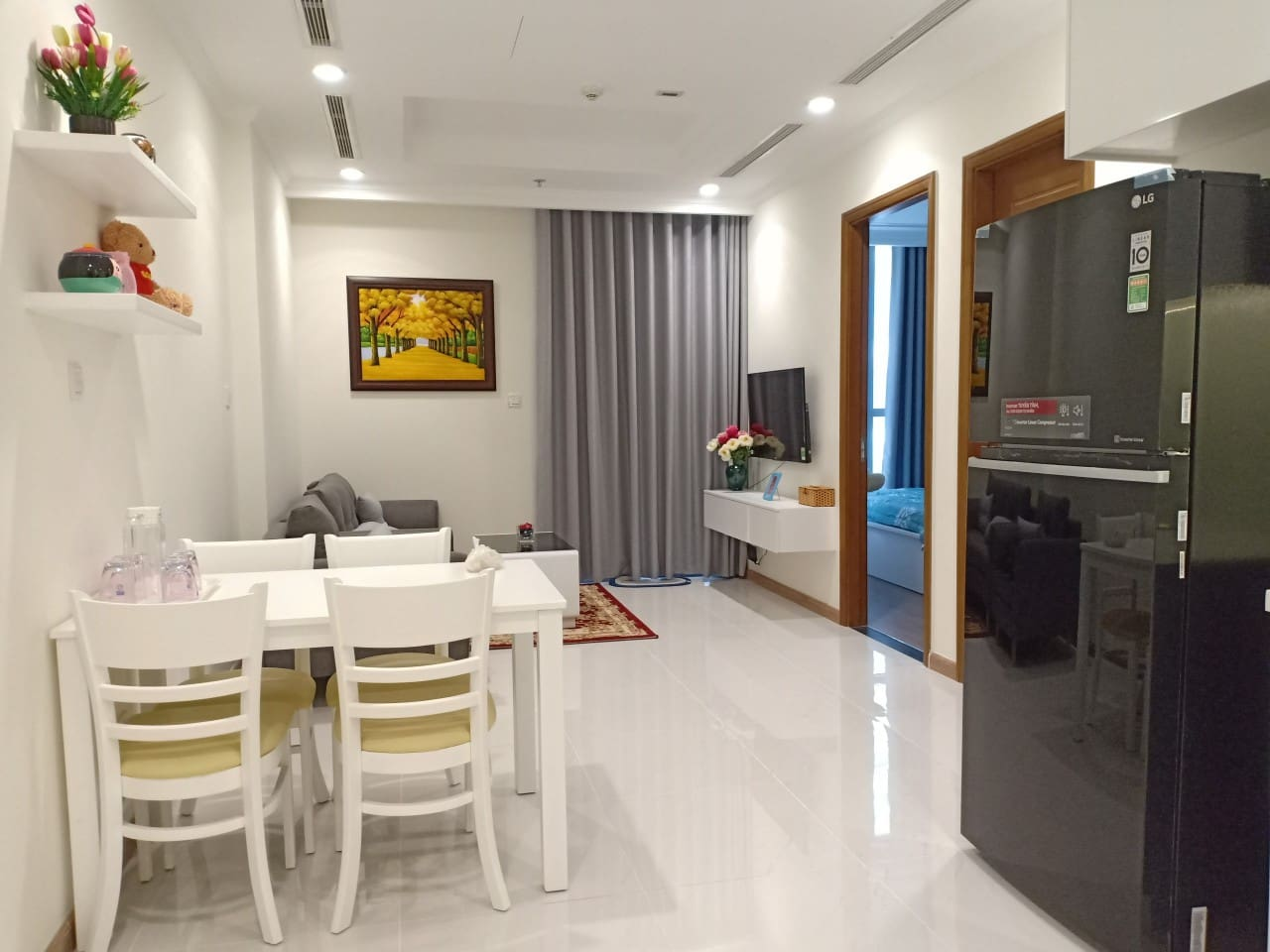 Dining area. Our kitchen is furnished with big fridge, cooking equipments and cutlery