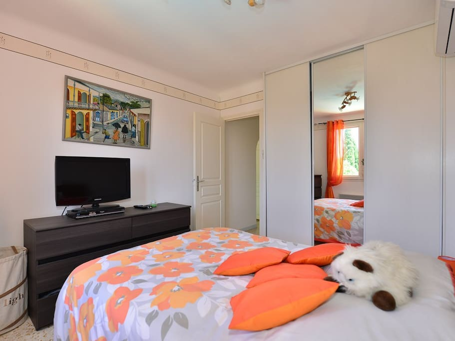 The double bedroom with its large fitted wardrobe, Flat screen TV and DVD player
