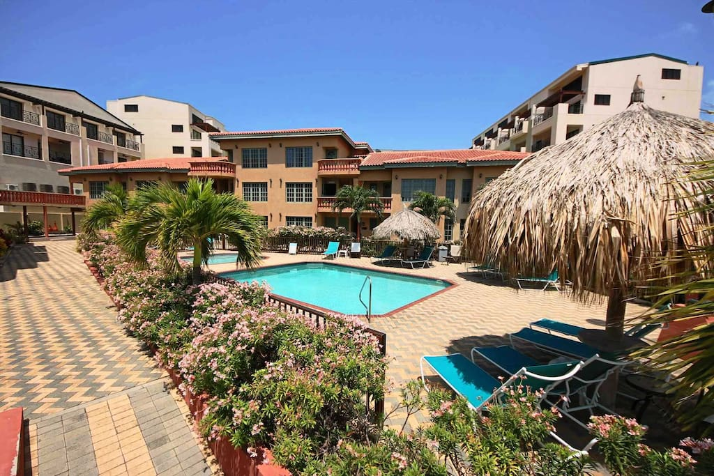 Swimming pool area right in front of your condo!
