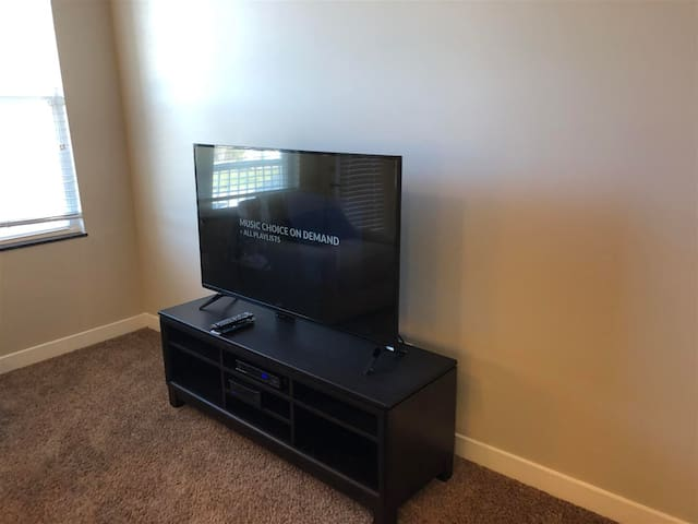 "Living Room TV - 55"" Ultra-HD SmartTV with cable service included. Wifi is also included!"