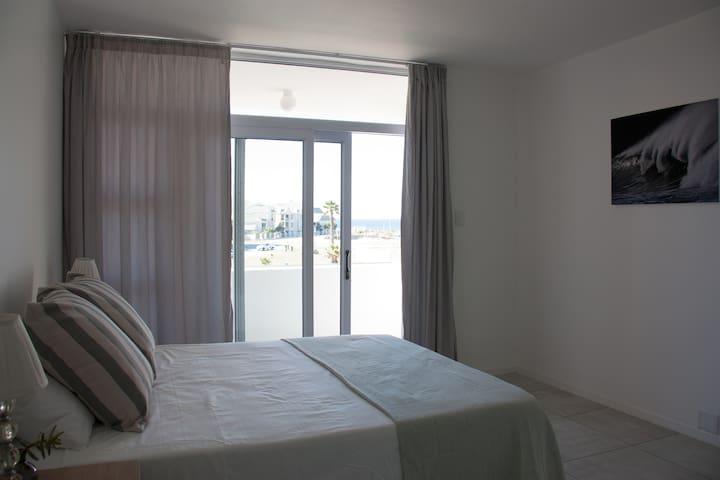 Main bedroom with balcony and sea views