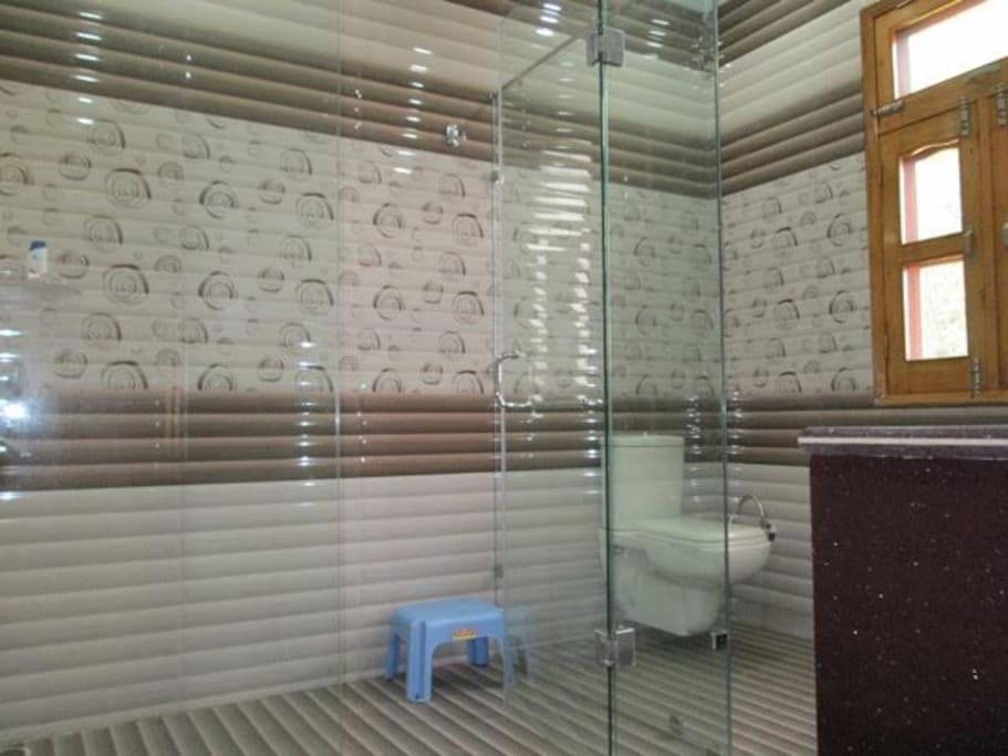 Attached washroom with glass separation