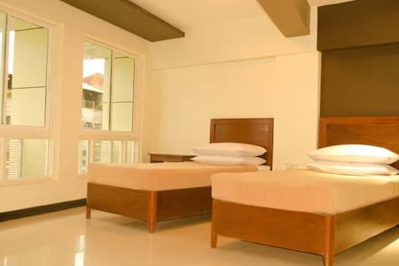 Palawan Palm Suites  17 Hotel Rooms, one 3BR suite - Bed & Breakfast