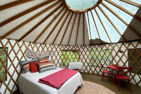Easy escape to a yurt in the forest+ bonus space.