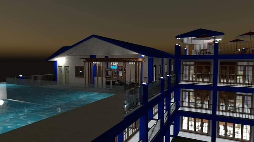 infinity pool and bar. recreational area located @ 4th floor