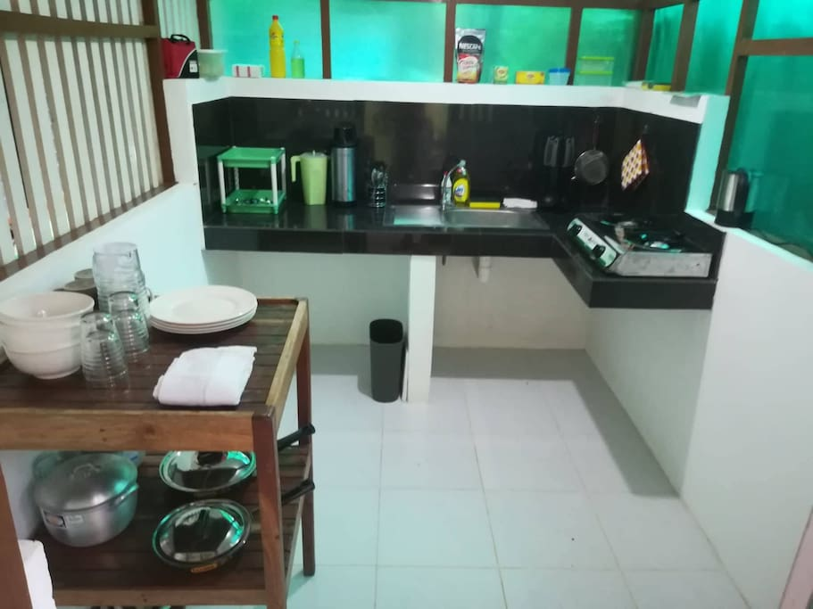 Kitchen is equipped with a gas stove, kettle, pots, pans and utensils. Also, free-flowing coffee and tea.