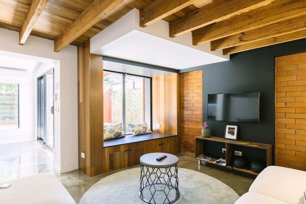 Wood, brick and black tastefully styled