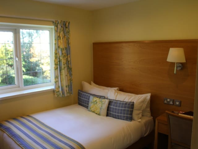 Cosy ensuite double in clothing optional spa hotel