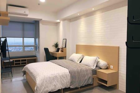 Cozy Studio Bedroom, Apartemen Skandinavia