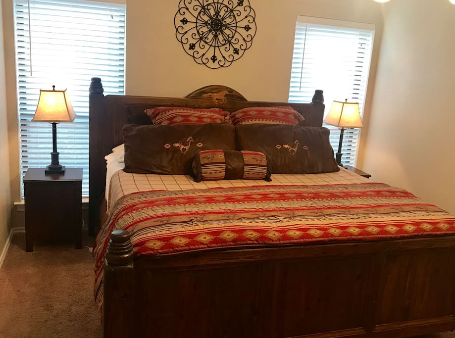 Master bedroom with king size bed, cable tv and bathroom.