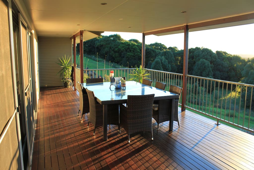Outdoor dining table on upper deck
