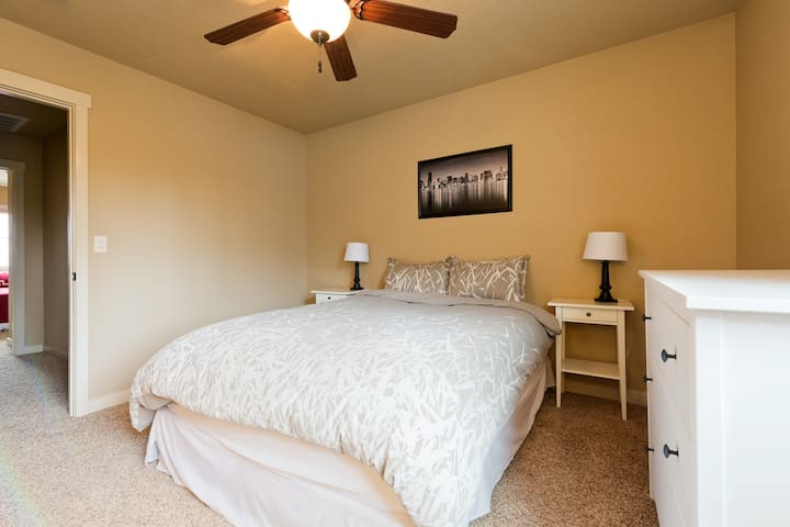 Master bedroom includes a walk-in closet, dresser, and master bathroom