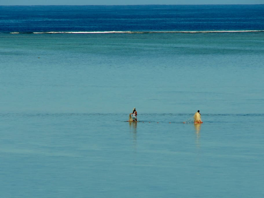 Native Fishermen applying their craft in the lagoon in front of the Villas
