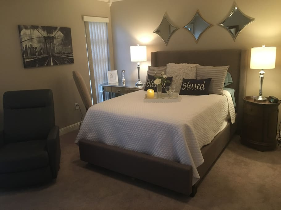 This is your room. Beautifully decorated. Desk, wing chair. Recliner, brand new bed, up graded linens.