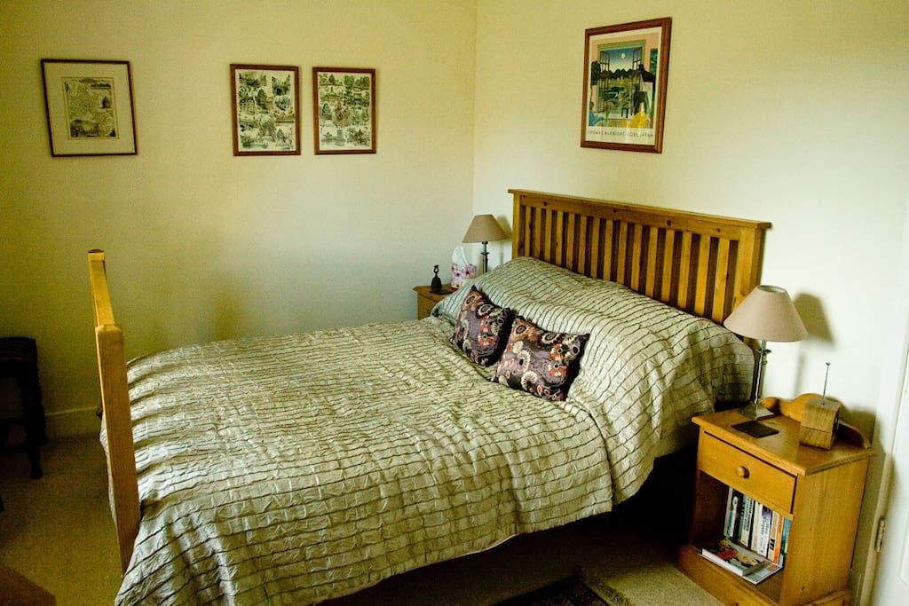 With views over the pretty garden, the bedroom is comfortably furnished in relaxing colours.