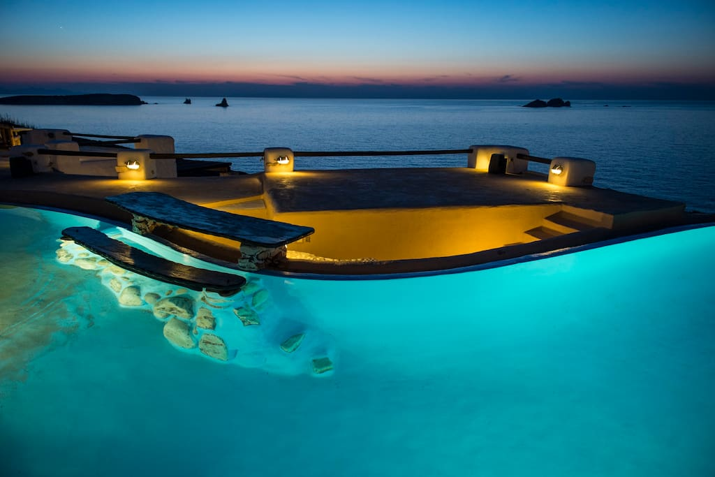 An exquisite beach-entry pool is the main attraction of the Villa: Beautifully aligned with the sea's horizon, with delightfully cool and clear waters - due to cutting-edge water clearing technology, inviting irregular shape and a dolphin sculptured at the base of a small waterfall, the pool feels more like your own private beach with a view!