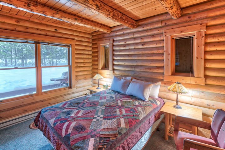 Enjoy tasteful cabin decor, warm lighting, and large windows in the bedrooms.