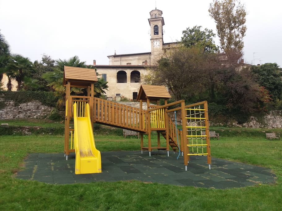 Playground in the park, next to café with tables, nice for a coffee or a drink.