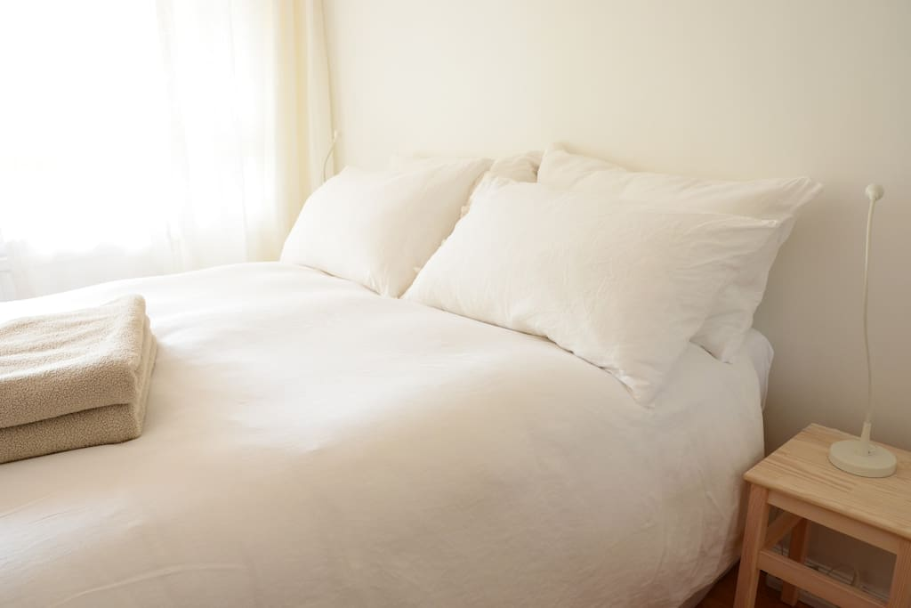 Soft feather pillows and linen duvet covers.