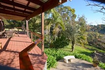 60 sqm deck with BBQ and access to garden.