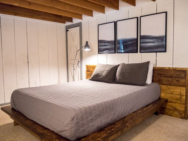 The second downstairs bedroom has a cozy feel and is great for late sleepers