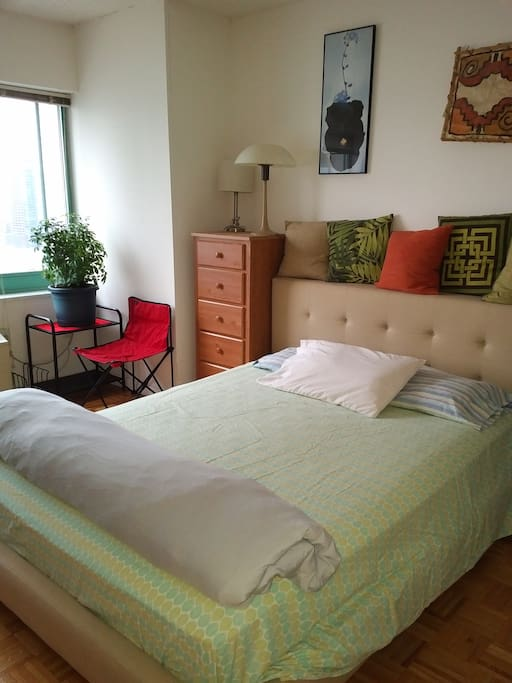 Sunny bedroom with high quality bed