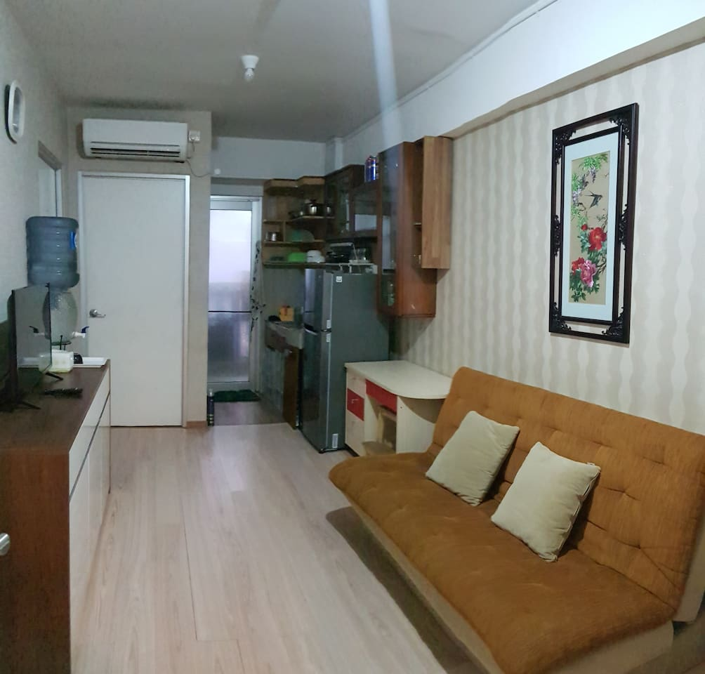 Living Room, with spacious area for walk across kitchen, bedroom 1 and 2