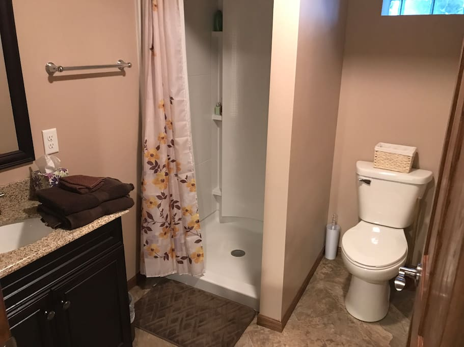Private bathroom with shower and sink
