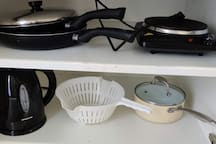 Electric kettle and cast iron hot plate as well as basic pots and pans.