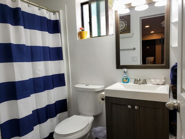 The private bathroom is connected to the bedroom.  In it you will find a shower/tub, toilet, sink, towels, and most amenities.  There is a hairdryer and soap.