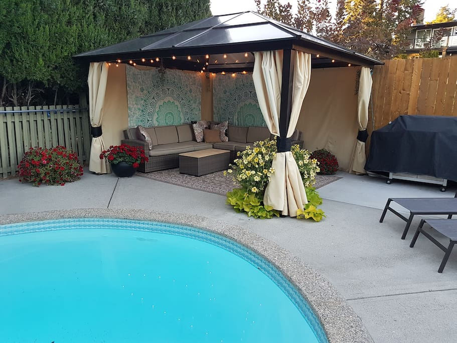 Poolside cabana complete with comfy couches and loungers