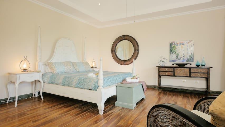 Grand Master Suite: King Bed (10' tall ceilings, teak floors)