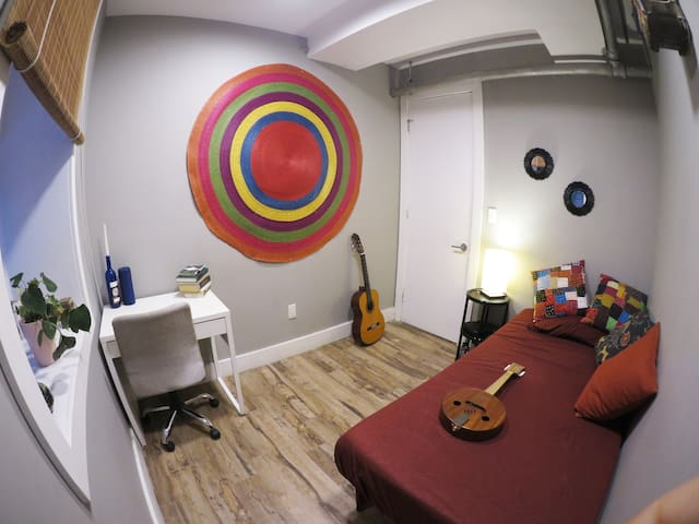 Welcome to NYC! This is your colorful room.