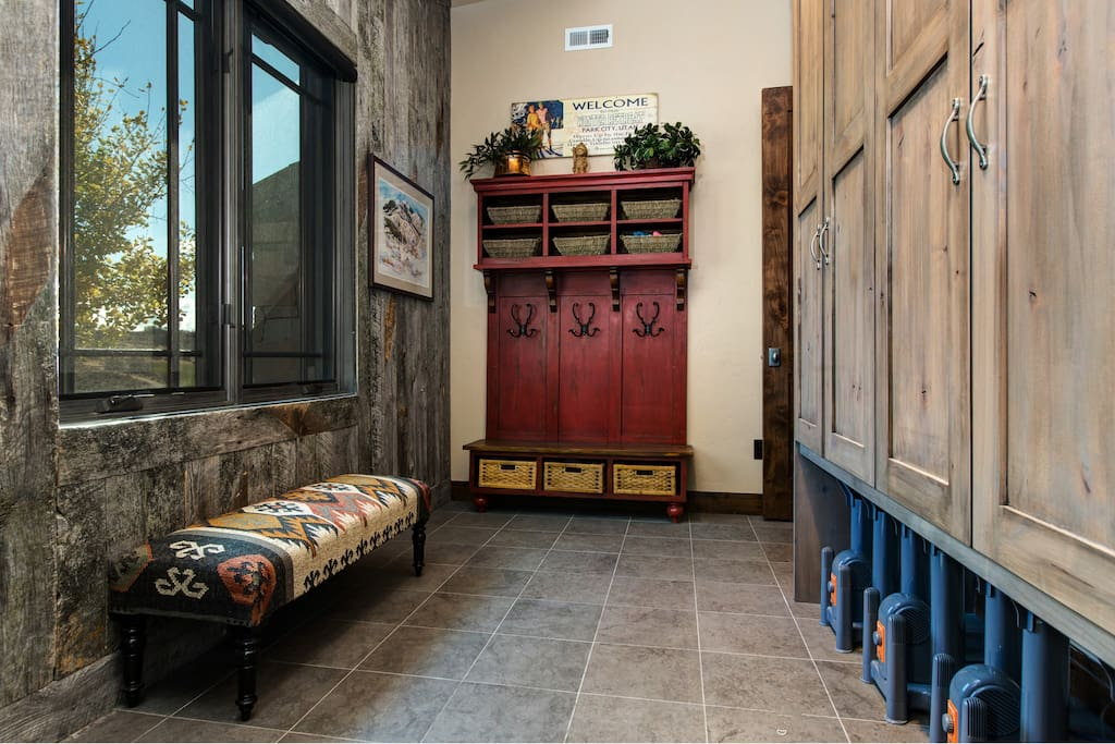 A large entryway offers lots of storage space and heaters for ski boots.