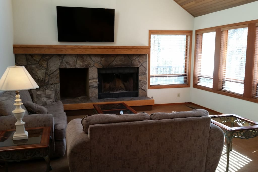 """Fire Place and 60"""" Flat Screen TV with HD Digital Cable Line Up"""