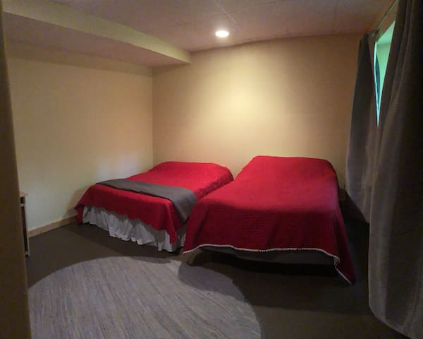 Basement bedroom: 2 double beds and black-out curtains